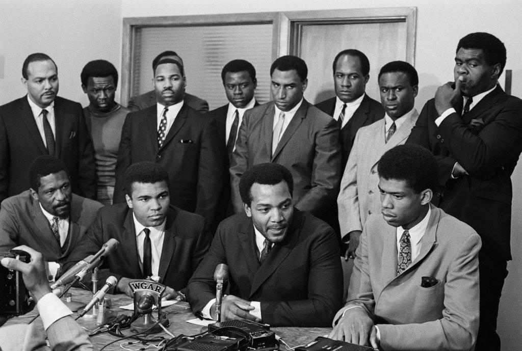 african-american-athletes-at-news-conference-af400c2cb31b07a9